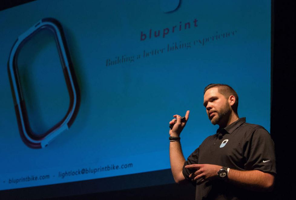 Thomas Blase, co-founder of Bluprint Inc., is one of nine graduates of the Regional Accelerator and Innovation Network's business accelerator in Eugene. Bluprint Inc. is focused on creating design-focused bicycle accessories to solve problems for riders (photo cred: Register Guard)